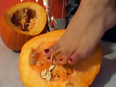 she is crushes a pumpkin with her feet