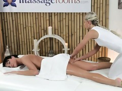 golden-haired masseuse rubbing and oiling snatch