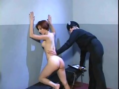 lesbo agent examining the holes of the prisoner